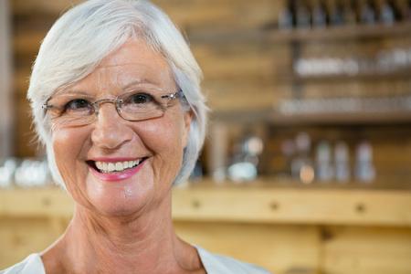 Portrait of smiling senior woman in café Stock Photo