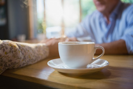 Close-up of coffee cup on table in café Stock Photo