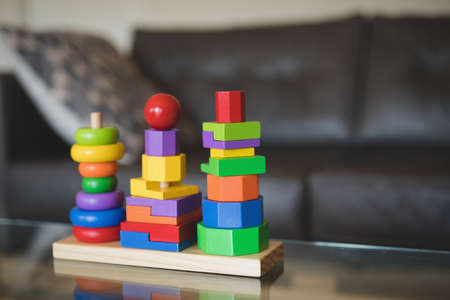 Close-up of colorful stacking toy on table in living room at home LANG_EVOIMAGES