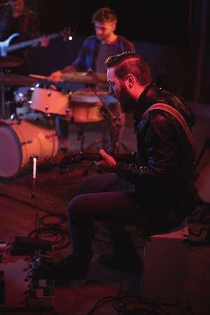 illuminated: Band performing in recording studio