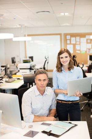 Portrait of business colleagues working together in office Stock Photo