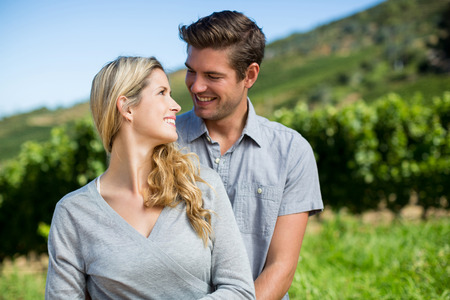 Happy young couple looking at each other in vineyard Stock Photo