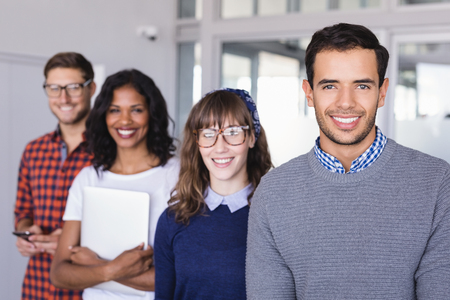 businesswear: Portrait of smiling colleagues standing in office Stock Photo