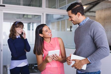 businesswear: Happy colleagues in corridor