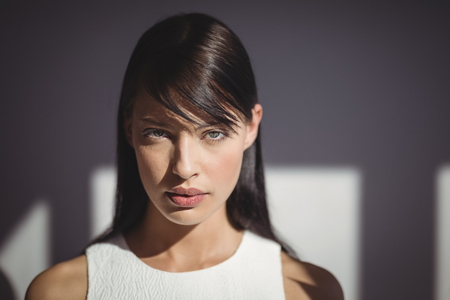 Close-up of beautiful woman looking at camera in office