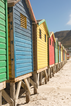 Close up of wooden huts on sand against clear sky at beach