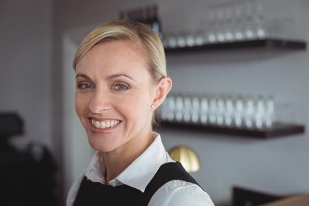 professional flute: Portrait of smiling waitress in restaurant Stock Photo