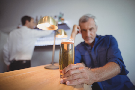 Portrait of mature man sitting at counter in restaurant Stock Photo