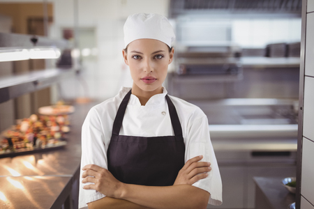 Portrait of female chef standing in the commercial kitchen