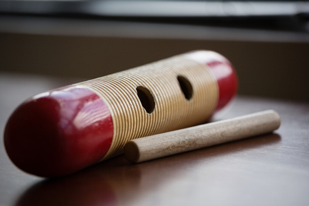Close up of musical instrument on wooden table in classroom