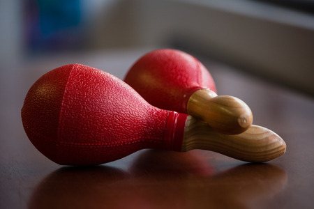 Close up of red maracas on table in classroom