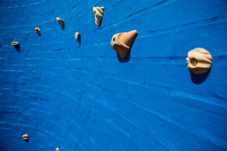 Full frame shot of blue climbing wall at school Stock Photo