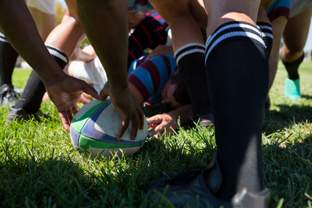 Close up of rugby team at field on sunny day