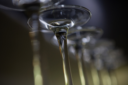Low angle view of wine glasses at bar counter