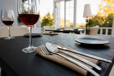 Red wine in glasses on table at restaurant Stock Photo