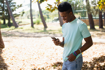 Young man using mobile phone in the park Stock Photo