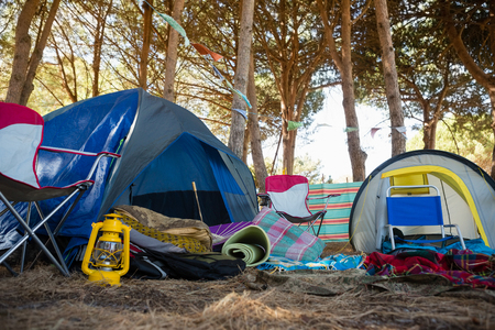 messed: Camping equipments in the park on a sunny day Stock Photo