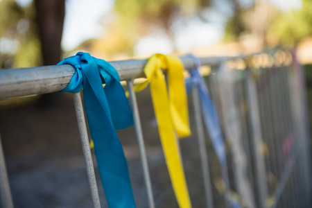 messed: Decorative ribbons tied on a railing in the park
