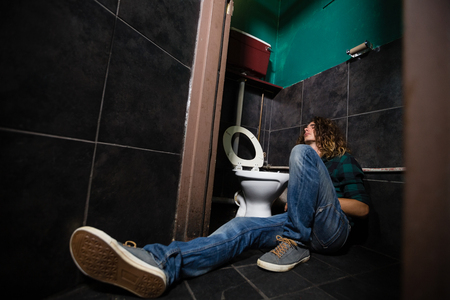 Unconscious man sleeping in the washroom