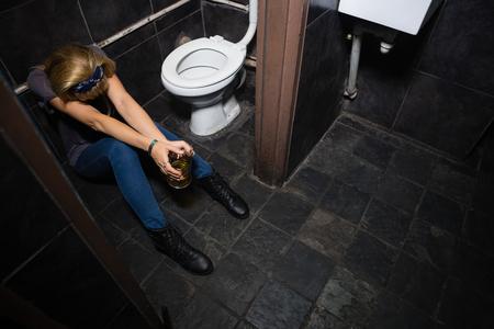 Unconscious woman sleeping in the washroom
