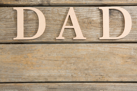 Close up of dad text on wooden planks Banco de Imagens