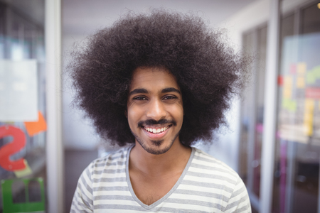 Close up portrait of smiling businessman with frizzy hair