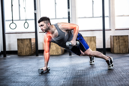 Digital composite of highlighted body of strong man lifting weights at gym Foto de archivo