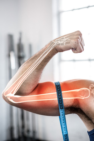 computer club: Digital composite of highlighted arm of man measuring biceps with measuring tape