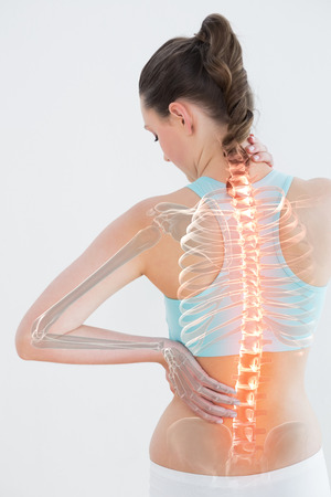 Digitally generated image of female suffering from muscle pain against white background