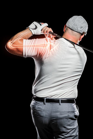 Digitally composite image of golfer playing against black background Stock Photo