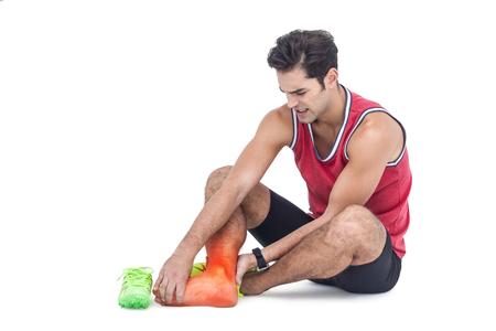 Digital composite of highlighted leg bones of injured man against white background