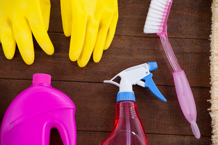 Close-up of various cleaning equipment arranged on wooden floor Stock Photo