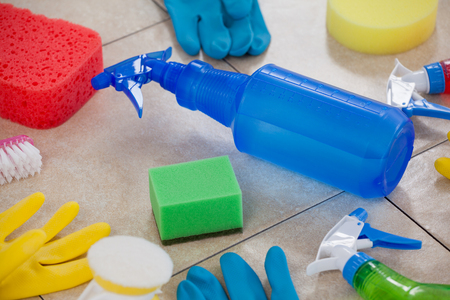 Close-up of various cleaning equipment on tiled floor Stock Photo