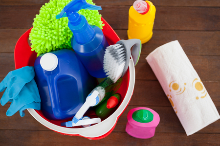 Close-up of bucket with cleaning supplies on wooden floor Stock Photo
