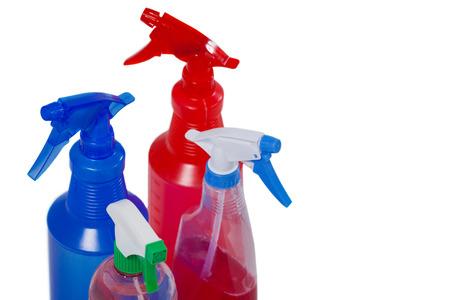 Various detergent bottles arranged on white background