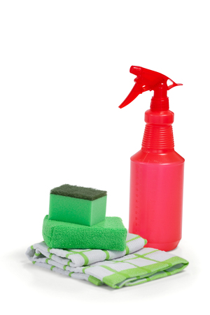 Detergent spray bottle, scouring pad and napkin cloth arranged on white background