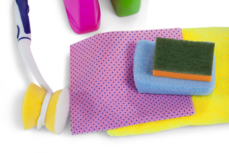 Detergent containers, scouring pad, towel, napkin cloth and cleaning brush arranged on white background