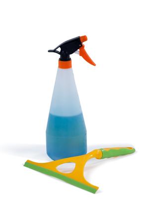 Detergent spray bottle and window squeegee arranged on white background Stock Photo