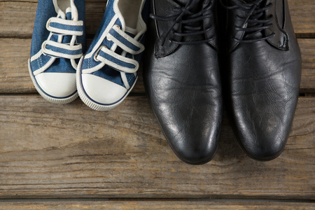 black leather texture: Overhead view of shoes on wooden table Stock Photo