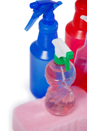 Various detergent spray bottle and sponge pad arranged on white background Stock Photo