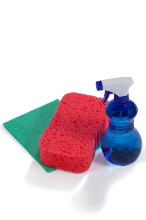 Detergent spry bottle, sponge pad and wipe pad arranged on white background