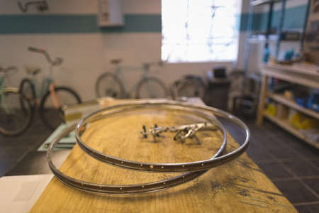 Wheels on table at vintage bicycle workshop