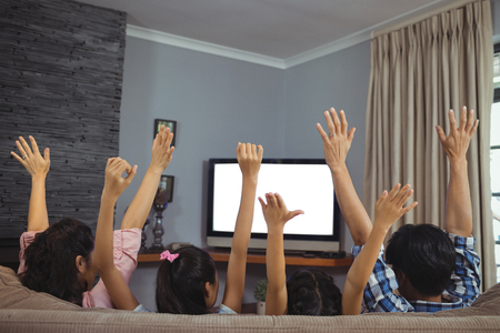 Family watching television together in living room at home Stock Photo