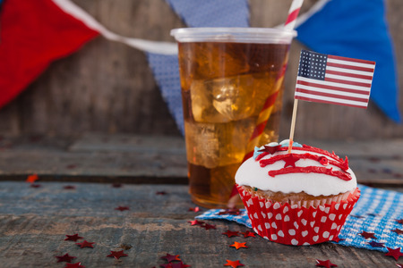 Decorated cupcake and cold drink with 4th July theme on wooden table Stock Photo