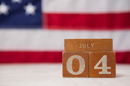 national identity: Close-up of date blocks arranged against American flag background