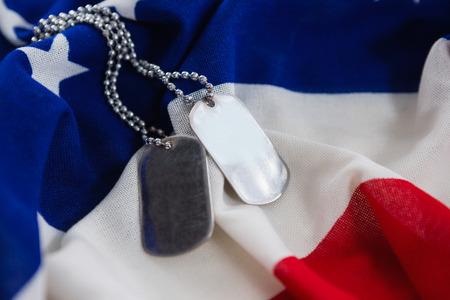 Close-up of dog tags chain on an American flag Stock Photo