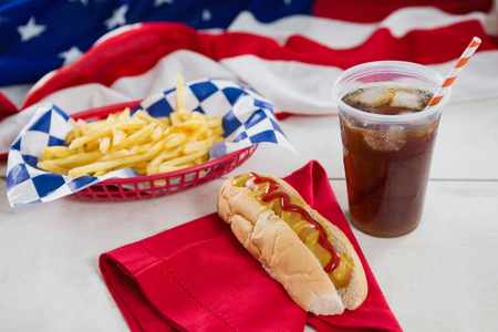 national identity: Close-up of American flag and hot dog on wooden table