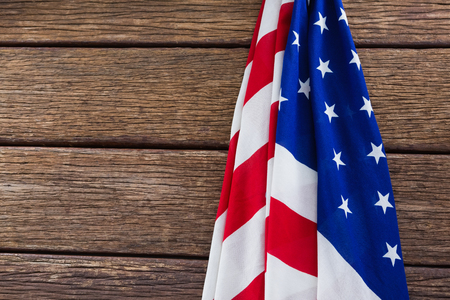 national identity: Close-up of an American flag on a wooden table