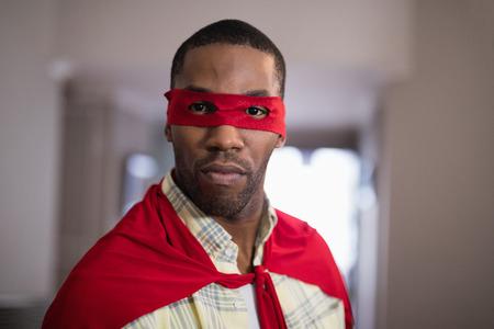 fictional: Close up portrait of man wearing superman costume