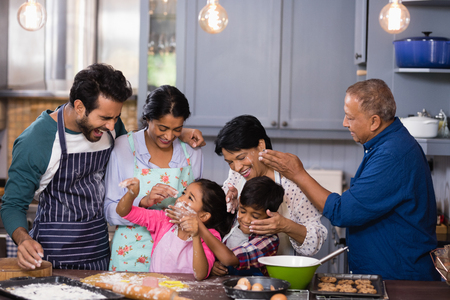 generation gap: Happy multi-generation family enjoying together in kitchen at home